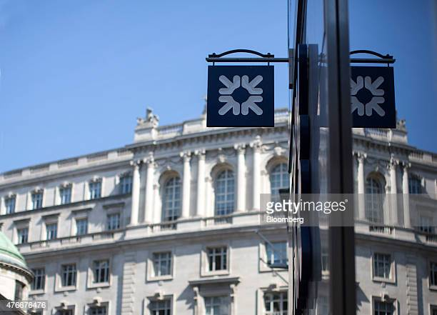 An RBS logo sits on a sign as it hangs outside a Royal Bank of Scotland Plc bank branch in London UK on Thursday June 11 2015 Chancellor of the...