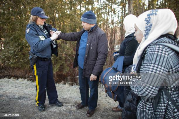 An RCMP officer handcuffs a man from Syria after he and his family illegally crossed the USCanada border near Hemmingford Quebec February 28 2017 /...