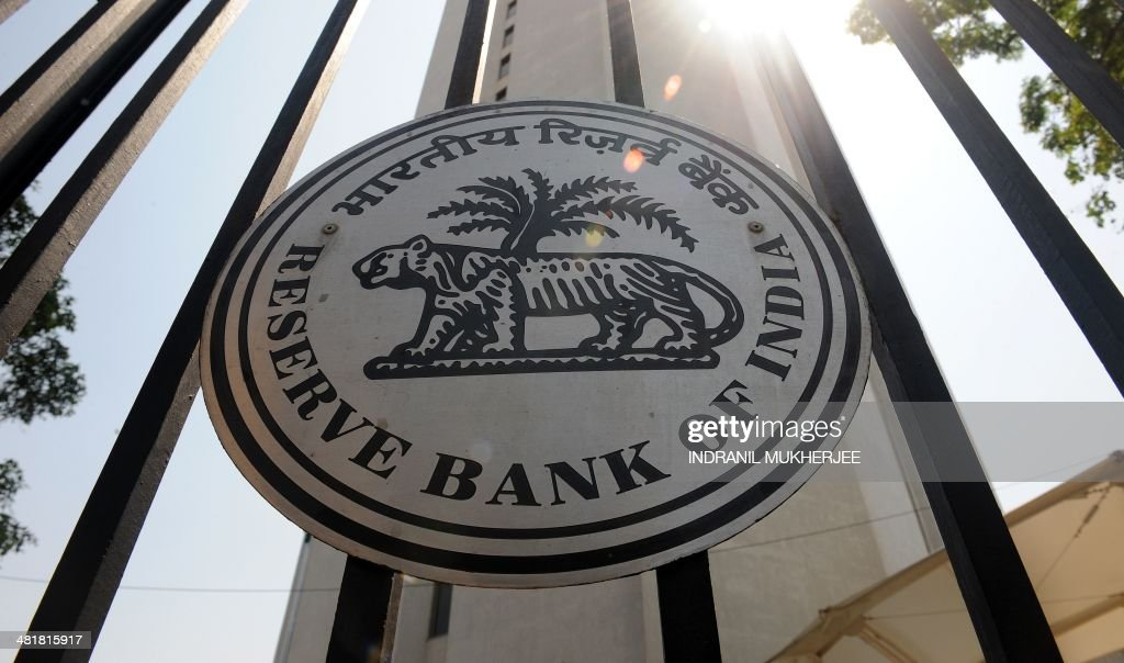 An Reserve Bank of India logo is seen on the main entrance gate of the RBI headquarters in Mumbai on April 1 2014 India's central bank kept key...