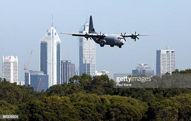 An Royal Australian Airforce C130 Hercules carrying casualties arrives at Perth International Airport on April 17 2009 in Perth Australia A boat...