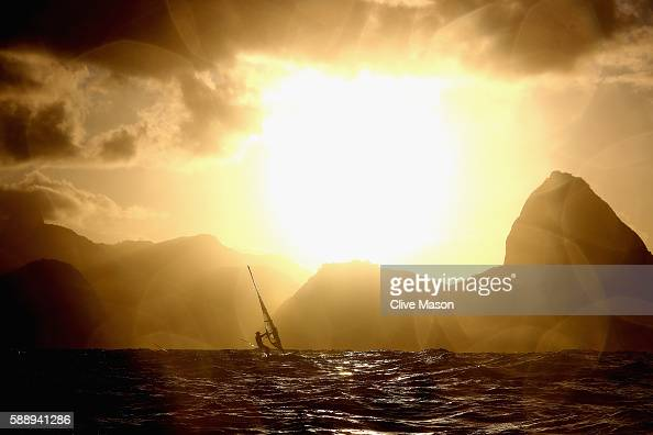 An RSX athlete is seen on the way back to the marina after the conclusion of racing on Day 7 of the Rio 2016 Olympic Games at Marina da Gloria on...