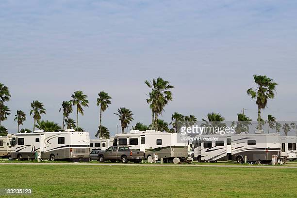 An RV park with the same RVs all in a row