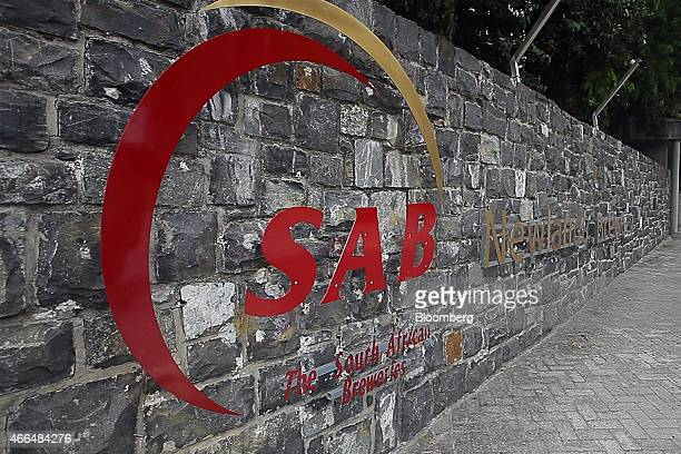 An SABMiller logo sits on display outside SABMiller Plc's Newlands brewery in Cape Town South Africa on Friday March 13 2015 SABMiller the world's...