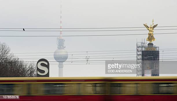An SBahn commuter train passes in front of the Berlin TV Tower and the victory column in Berlin January 3 2011 The subsidiary company of the Deutsche...