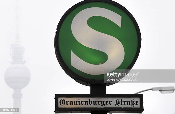 An SBahn sign indicates the Oranienburger strasse station with the TV tower in the background in Berlin January 13 2010 AFP PHOTO / JOHN MACDOUGALL
