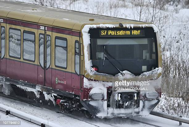 An Sbahn train covered in snow makes its way through Berlin December 28 2010 Forecasts predict temperatures staying below zero AFP PHOTO / JOHN...