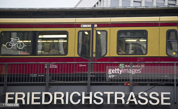 An SBahn train crosses the bridge over Berlin's Friedrichstrasse May 31 2011 AFP PHOTO / JOHN MACDOUGALL
