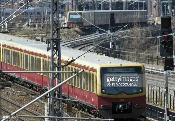 An SBahn train of the Deutsche Bahn leaves the Ostbahnhof railway station in Berlin on March 27 2014 AFP PHOTO / JOHN MACDOUGALL