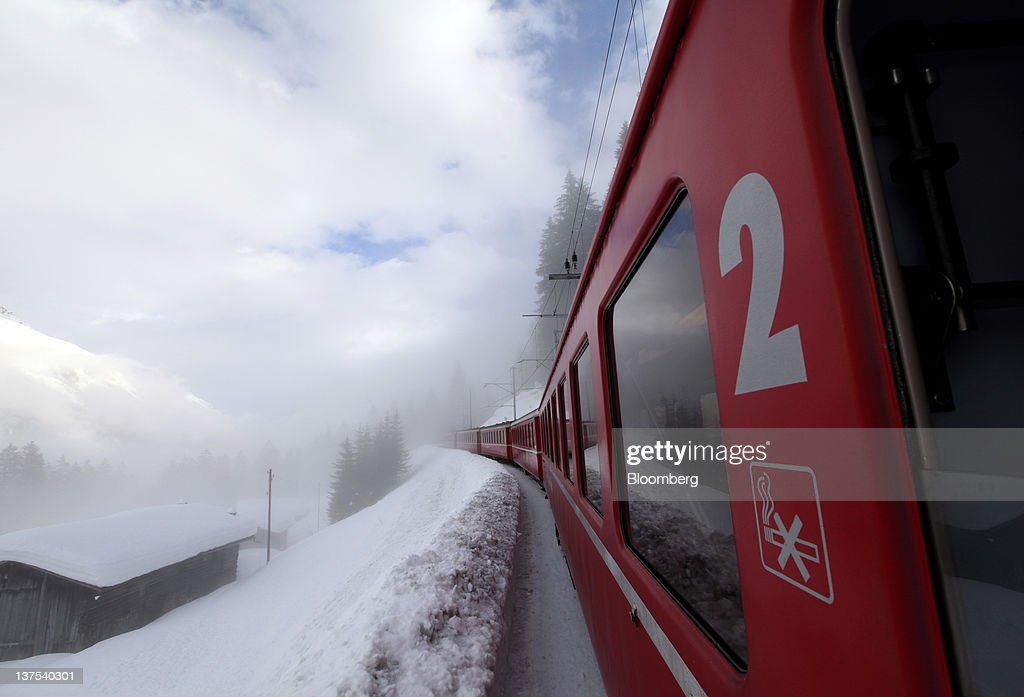 An SBB AG train makes its way through low based cloud on the way towards the town of Davos, the venue of the World Economic Forum's (WEF) 2012 annual meeting, in Davos, Switzerland, on Sunday, Jan. 22, 2012. German Chancellor Angela Merkel will open next week's World Economic Forum in Davos, Switzerland, which will be attended by policy makers and business leaders including U.S. Treasury Secretary Timothy F. Geithner. Photographer: Chris Ratcliffe/Bloomberg via Getty Images