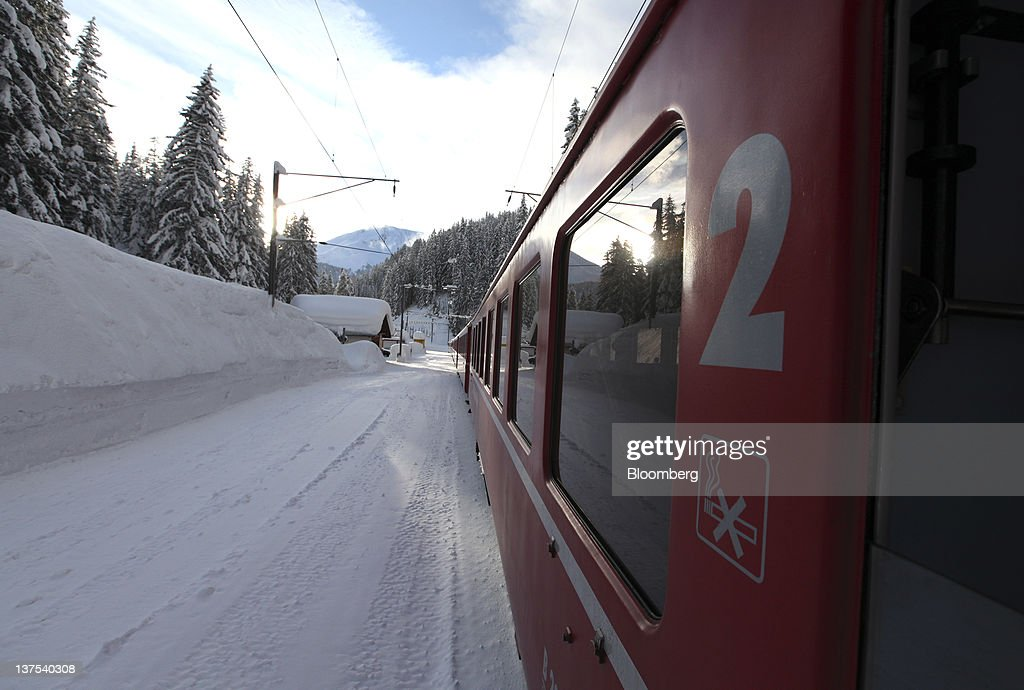 An SBB AG train makes its way towards the town of Davos, the venue of the World Economic Forum's (WEF) 2012 annual meeting, in Davos, Switzerland, on Sunday, Jan. 22, 2012. German Chancellor Angela Merkel will open next week's World Economic Forum in Davos, Switzerland, which will be attended by policy makers and business leaders including U.S. Treasury Secretary Timothy F. Geithner. Photographer: Chris Ratcliffe/Bloomberg via Getty Images