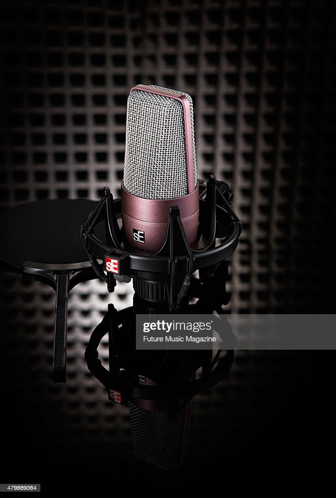 An sE Electronics Magneto condenser microphone photographed against black acoustic foam taken on February 7 2014