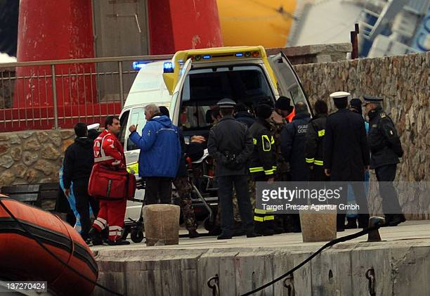 An seriously injured rescuer is taken away by an ambulance He was working on the stricken cruise Costa Concordia near a new entrance created by an...
