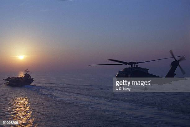An Sh60H Seahawk From The Helicopter AntiSubmarine Squadron Six Approaches The USS Carl Vinson At The Completion Of The Days Mission As Part Of...