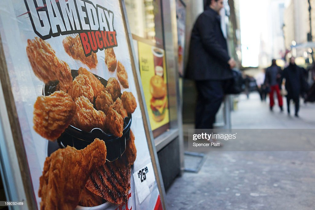 An sign advertising chicken stands on a street on January 10, 2013 in New York City. A new London-based study by the The Institution of Mechanical Engineers found that as much as half of the food produced in the world ends up going to waste. The study found that irresponsible retailer and consumer behavior contributed to 1.2 billion to two billion of the four billion metric tons of food produced globally that goes uneaten.