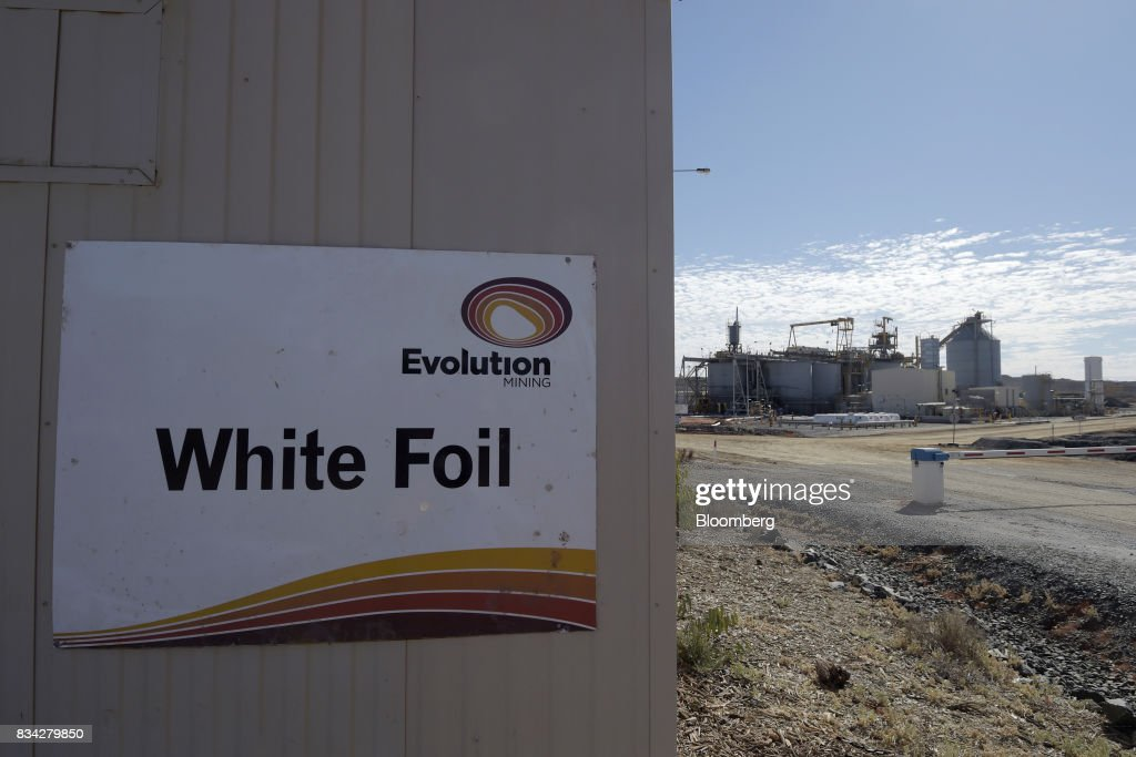 An sign for the White Foil open pit mine is displayed at an administration building of Evolution Mining Ltd.'s gold operations in Mungari, Australia, on Tuesday, Aug. 8, 2017. Evolution Mining is Australias second-largest gold producer. Photographer: Carla Gottgens/Bloomberg via Getty Images