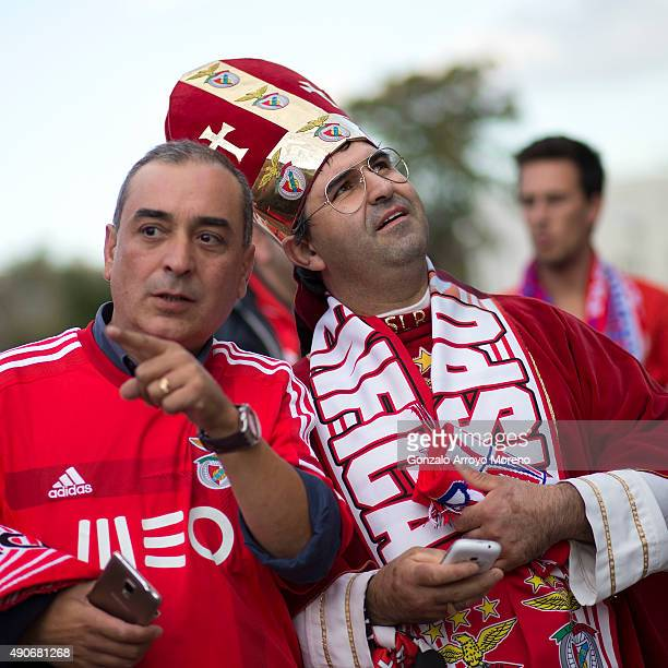An SL Benfica fan dressed up as a bishop looks up at Vicente Calderon Stadium before the UEFA Champions League Group C match between Club Atletico de...