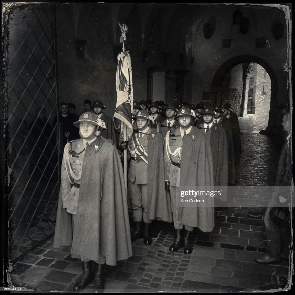 An squadron of army soldiers stand out of the rain while attending church services at Wawel Cathedral in Krakow Poland celebrating The Feast of...