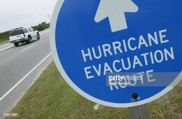 An SUV drives down a road in the Outer Banks September 17 2003 in Nags Head North Carolina Hurricane Isabel is churning toward the Outer Banks a thin...