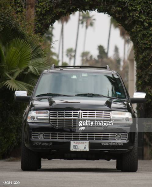 An SUV with guests of Mick Jagger and close family members of his late girlfriend LWren Scott departs Hollywood Forever Cemetery in Hollywood...