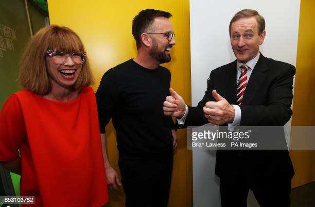 An Taoiseach Enda Kenny TD with 'Off the Rails' duo Sonya Lennon and Brendan Courtney at the announcement of details of the Action Plan for Jobs 2014...