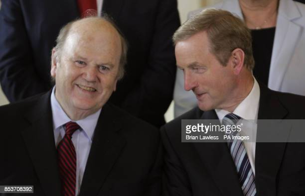 An Taoiseach Enda Kenny with Minister for Finance Michael Noonan at Aras an Uachtarain Dublin after today's cabinet reshuffle as the Fine GaelLabour...