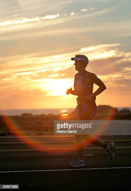 An triathlete runs during the Ford Ironman World Championship on October 15 2005 in Kona Hawaii Over 1800 athletes from all over the world...