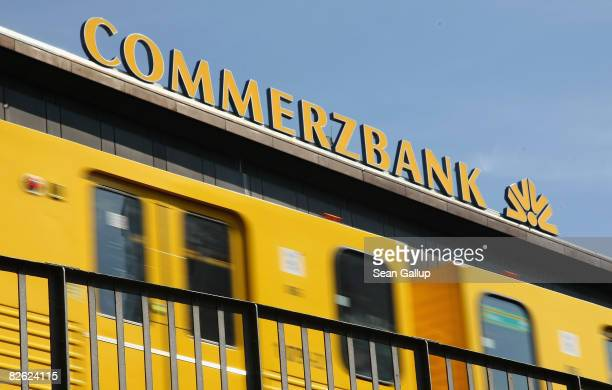 An Ubahn commuter train drives past a branch of Commerzbank on September 2 2008 in Berlin Germany German insurer Allianz which bought Dresdner Bank...