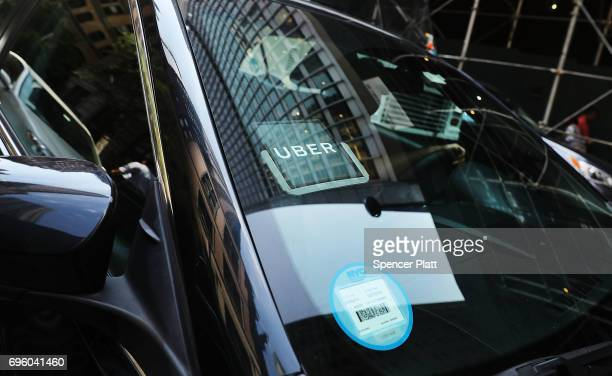 An Uber car waits for a client in Manhattan a day after it was announced that Uber cofounder Travis Kalanick will take a leave of absence as chief...