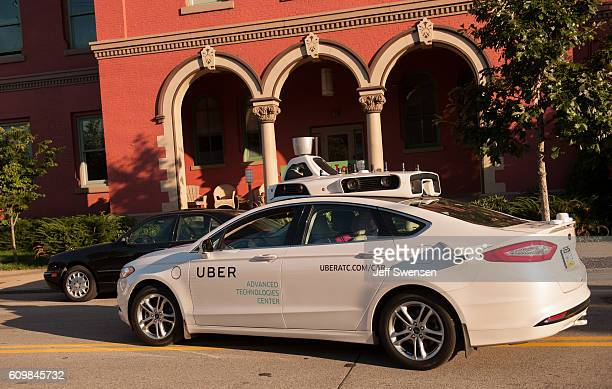 An Uber driverless Ford Fusion drives down Smallman Street on September 2016 in Pittsburgh Pennsylvania Uber has built its Uber Technical Center in...