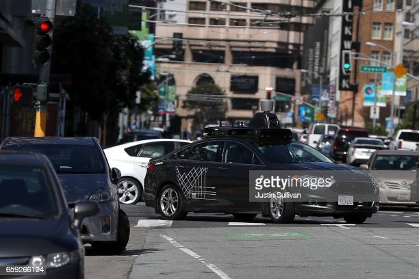 An Uber selfdriving car drives down 5th Street on March 28 2017 in San Francisco California Cars in Uber's selfdriving cars are back on the roads...