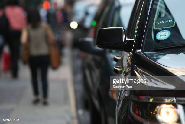 An Uber SUV waits for a client in Manhattan a day after it was announced that Uber cofounder Travis Kalanick will take a leave of absence as chief...