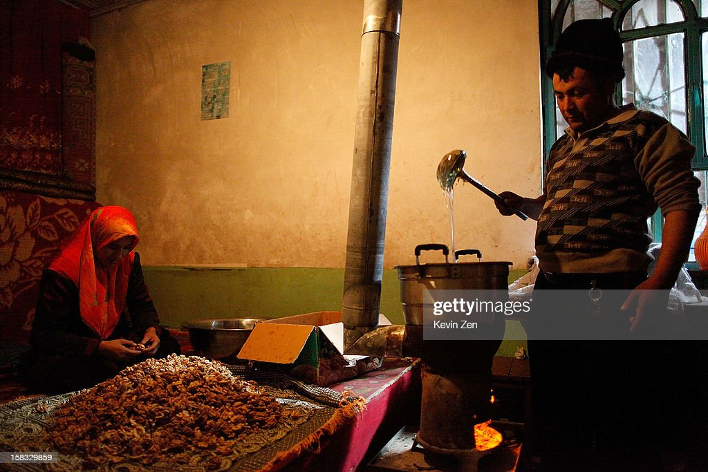 An Uighur man is in the production of traditional nut cake with his wife in Kashgar, on December 10, 2012 in Kashi, China. Kashgar is home to the ethnic Uyghur Muslim community.