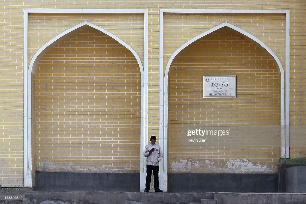 An Uighur man stands in front of It Garang square in Kashgar, on December 10, 2012 in Kashi, China. Kashgar is home to the ethnic Uyghur Muslim community.