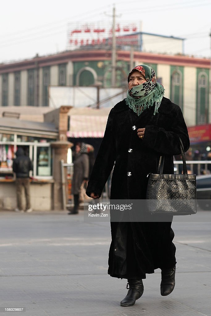 An Uighur woman wears headscarves across the street in Kashgar, on December 10, 2012 in Kashi, China. Kashgar is home to the ethnic Uyghur Muslim community.