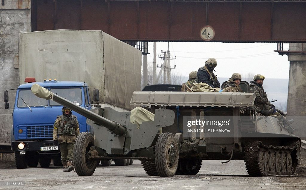 An Ukrainian Armoured Personnel Carrier stops along the route as they move cannons from their position near eastern Ukrainian city of Artemivsk in...
