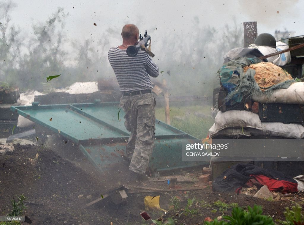 An Ukrainian serviceman fires with a grenade launcher on positions on the frontline of fighting against proRussian separatists near Donetsk on May 30...