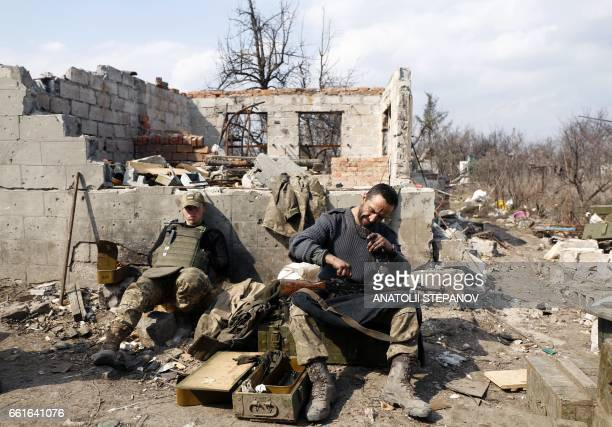 TOPSHOT An Ukrainian serviceman prepares ammunition for the fighting with proRussian separatists in Avdiivka Donetsk region on March 30 2017 US...