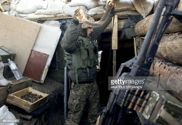 An Ukrainian serviceman prepares ammunition for the fighting with proRussian separatists in Avdiivka Donetsk region on March 31 2017 US Secretary of...