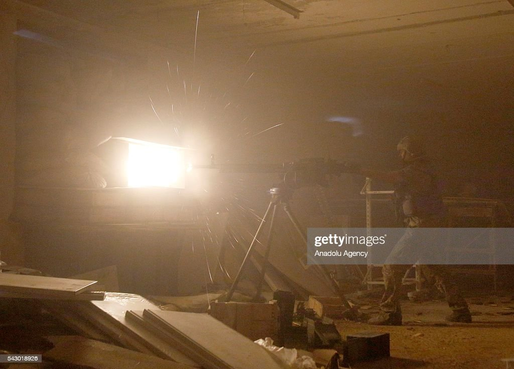 An Ukrainian soldier fires machine gun during the fight with the pro-Russian separatists at the Avdiivka industrial zone (Promka) in Avdiivka, Donetsk region, Ukraine, June 25, 2016.