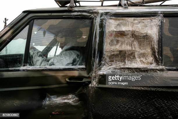 An Ukrainian soldier is seen driving a damaged Jeep near Donetsk Ukrainian soldiers are dependent on vehicles bought by themselves or supplied by...