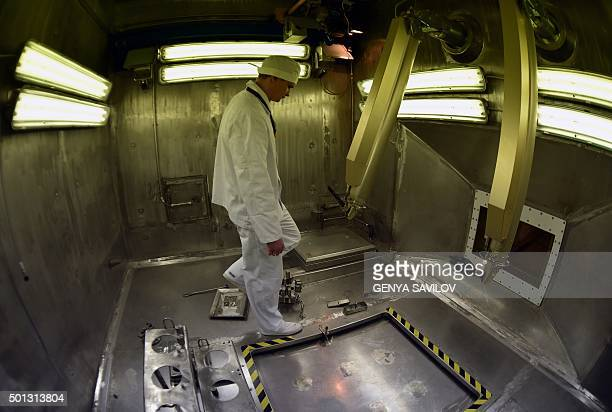 An Ukrainian worker inspects a hot cell in preparation for its activation in the centralized store facility for longterm storage of sealed...
