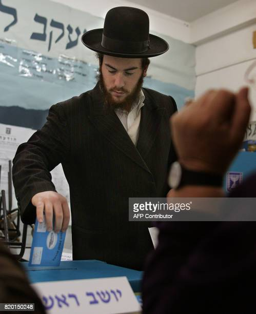 An Ultra Orthodox Jew casts his vote at a Jerusalem polling station 28 March 2006 during the Israeli general elections Turnout was running at the...