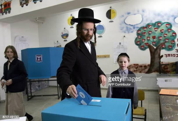 An Ultra Orthodox Jew casts his vote in Jerusalem 28 March 2006 for the Israeli general election Turnout was running at the relatively low level of...