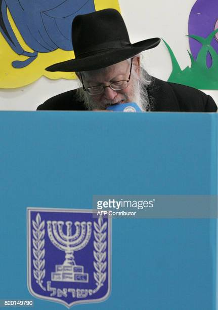 An Ultra Orthodox Jew prepares to cast his vote at a Jerusalem polling station 28 March 2006 during the Israeli general elections Turnout was running...