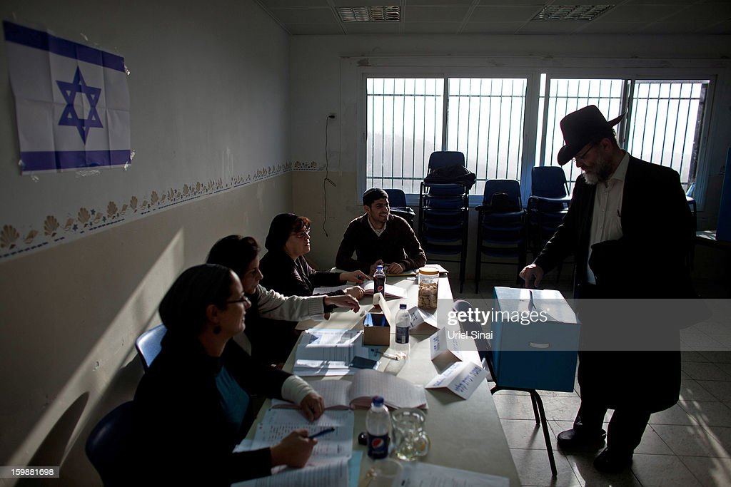 An Ultra Orthodox Jewish man casts his vote at a polling station on January 22, 2013 in Kiryat Ye'arim, Israel. The latest opinion polls suggest that current Prime Minister Benjamin Netanyahu will return to office, albeit with a reduced majority.