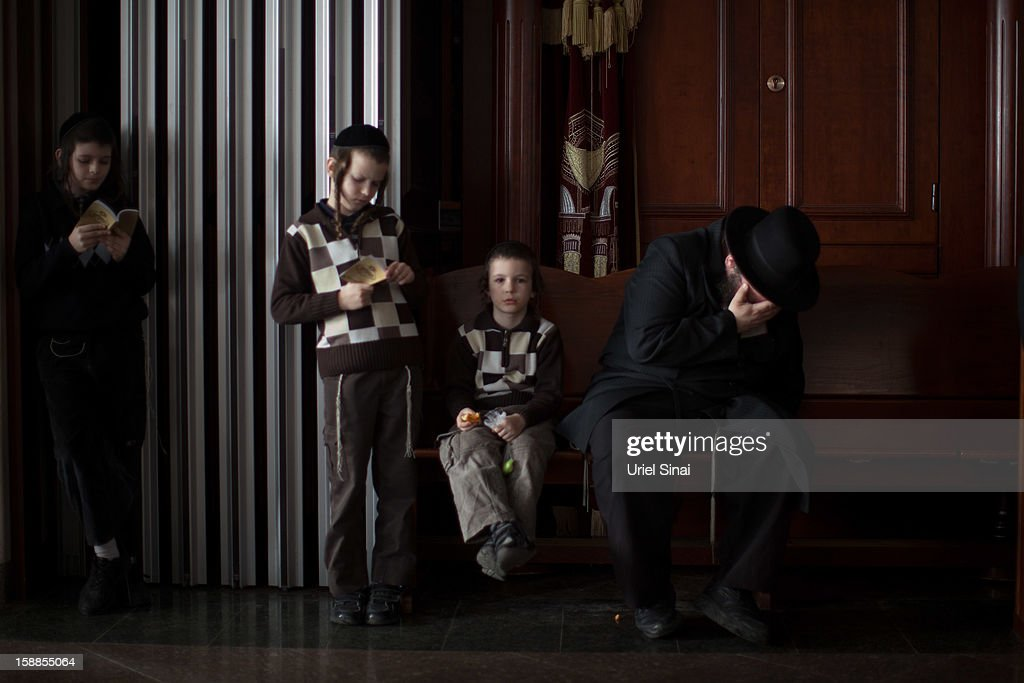 An Ultra Orthodox Jewish man cries at the funeral of Rabbi Abraham Jacob Friedman of Sadigura Hasidic dynasty on January 01, 2013. in Bnei Brak, Israel. The Rabbi was the leader of the Sadigura Hasidic dynasty in Bnei Brak and died at the age of 84.