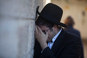An Ultra Orthodox Jewish man cries during the funeral of Rabbi Moshe Twersky on November 18 2014 in Jerusalem Israel Two Palestinians armed with a...