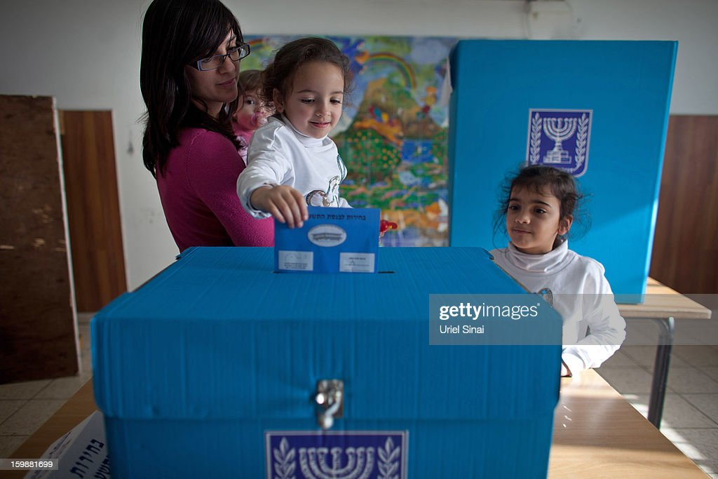An Ultra Orthodox Jewish woman and her children casts their vote at a polling station on January 22, 2013 in Kiryat Ye'arim, Israel. The latest opinion polls suggest that current Prime Minister Benjamin Netanyahu will return to office, albeit with a reduced majority.
