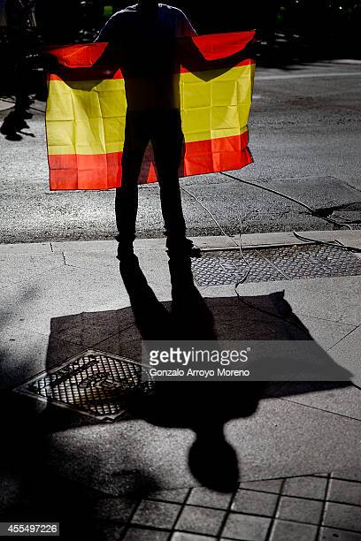 An ultra right wing party sympathizer holding a Spanish flag protests against the Catalonia independence process outside Spain's National Court...