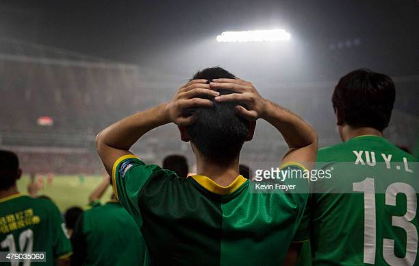 An Ultra supporter of the Beijing Guoan FC reacts during a match against Chongcing Lifan FC during their Chinese Super League play on June 28 2015 in...